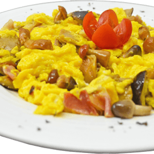 Scrambled eggs with mushrooms and ham